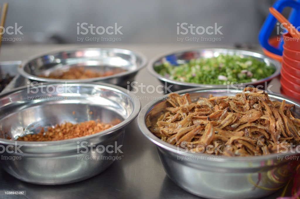 A market stall full of ingredients for Chinese traditional noodles. Jalan Petaling, Kuala Lumpur, Malaysia stock photo