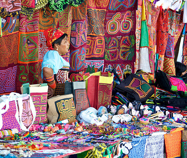 Market stall in Panama Panama City, Panama - January 18, 2014: A Kuna woman selling molas in an open air market in Panama City. The Kuna people, also known as Guna, are indigenous people of Panama and Colombia. yala stock pictures, royalty-free photos & images