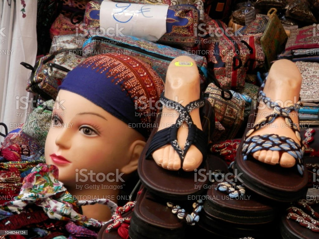 Market stall selling leather goods in Arab quarter stock photo