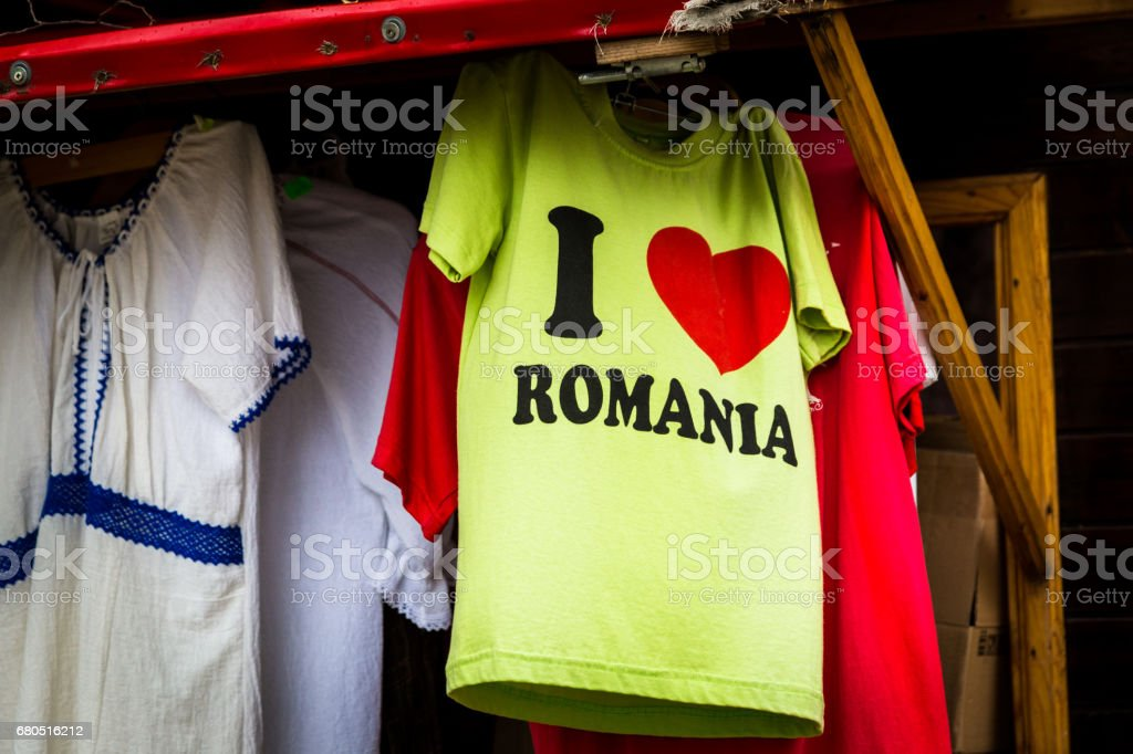 Market stall selling traditional Romanian clothing as well as a t-shirt with the slogan 'I love Romania' stock photo