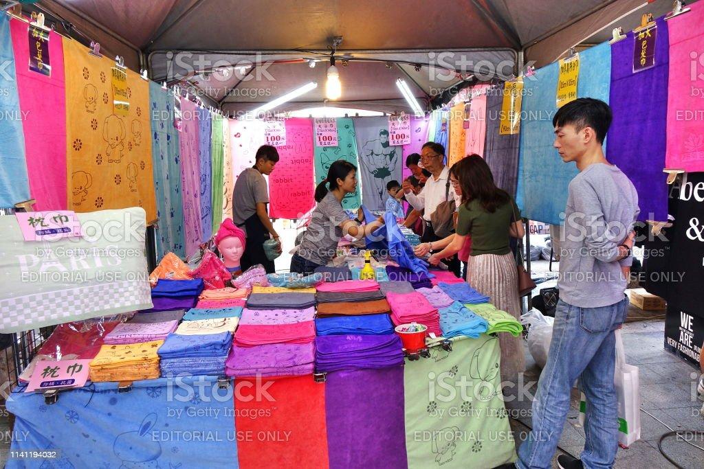 Market Stall Sells Towels stock photo