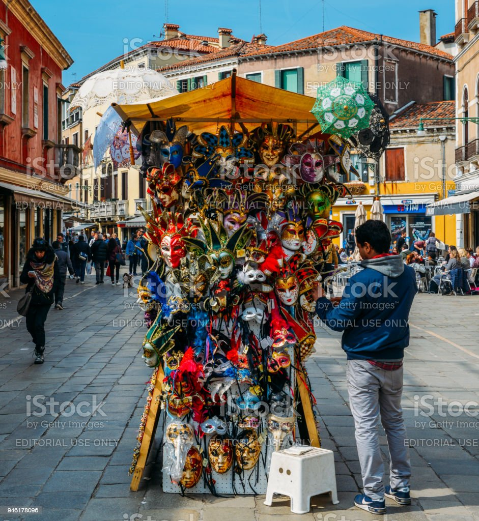 Market stalls in Venice selling Venetian masks among other souvenirs stock photo