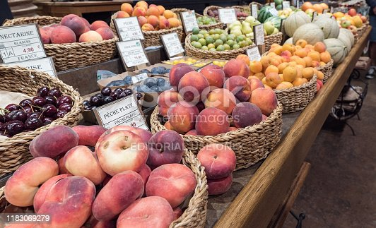 Saint-Vaast-la-Hougue, Manche / France - 16 August, 2019: market stand with many different fruit and labels with names and prices in French