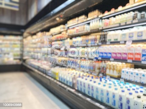 Market store or marketplace shopping blur background of supermarket indoor grocery retail shop with blurry food products and diary supplies on shelves in aisle