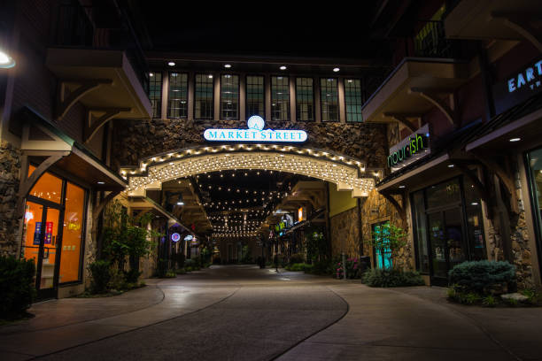 Market Street Shops On The Island In Pigeon Forge Pigeon Forge, Tennessee, USA - May  15, 2017: The Market Street shops are part of the Island entertainment complex in the Smoky Mountain resort town of Pigeon Forge, Tennessee. pigeon forge stock pictures, royalty-free photos & images