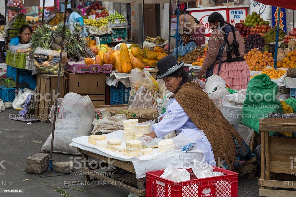 Market woman selling cheese in La Paz, Bolivia stock photo