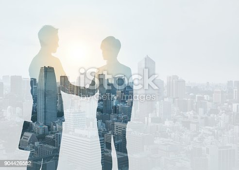 istock Marketing communication concept. Silhouette of business persons shaking hands. 904426582
