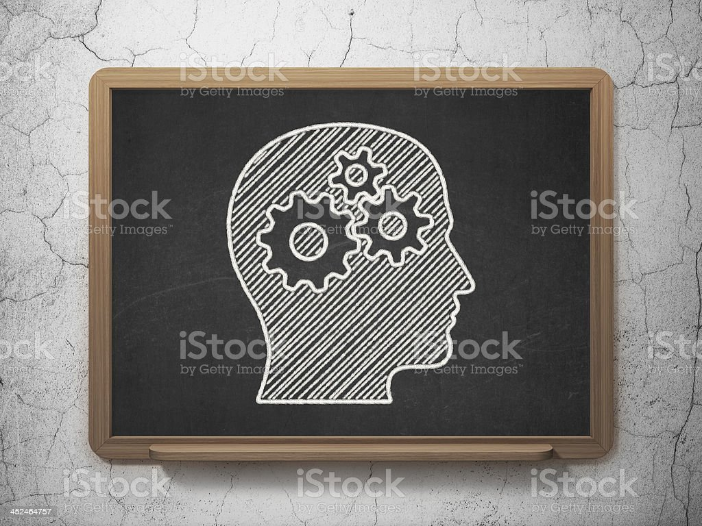 Marketing concept: Head With Gears on chalkboard background royalty-free stock photo