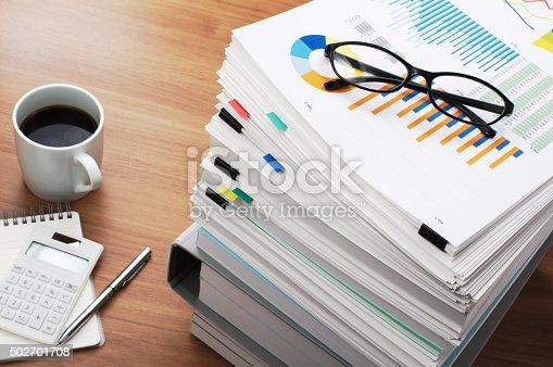 468153365 istock photo Marketing data analysis. Wooden table. 502701708
