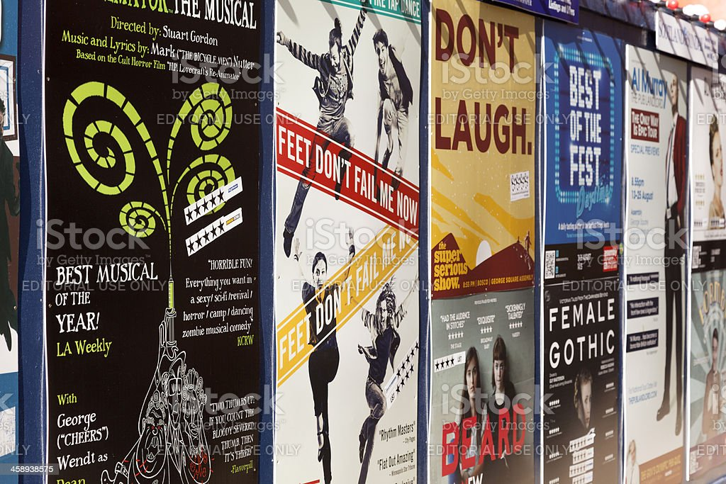 "Marketing posters at Edinburgh's fringe festival. ""Edinburgh, Scotland - August 16, 2012: Advertising posters at Edinburgh's fringe festival displayed on a wall."" Advertisement Stock Photo"