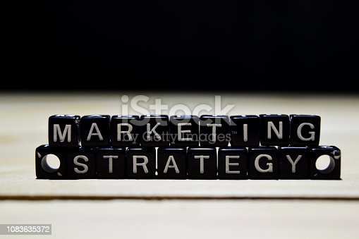 625727674 istock photo Marketing Strategy concept wooden blocks on the table. 1083635372