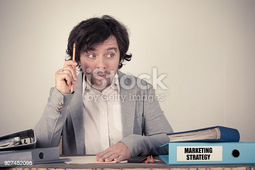 625727674 istock photo Marketing Strategy text on the binder, worried bussinesman thinking by the work desk 927452098