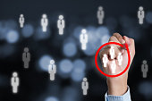 istock Marketing target audience concept , Businessman writing red circle to mark to focus customer group. 1276633924