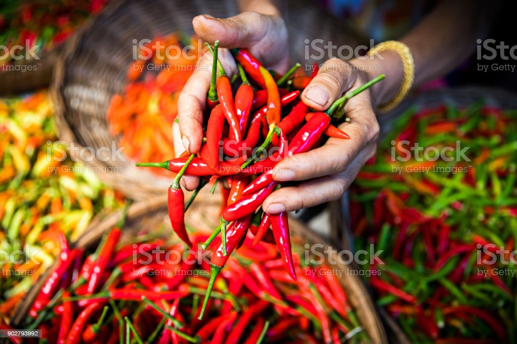 Marketplace: Handful of chillies stock photo