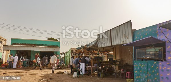 Khartoum, Sudan, ca. February 8., 2019: Marketplace with people shopping in a village in the desert