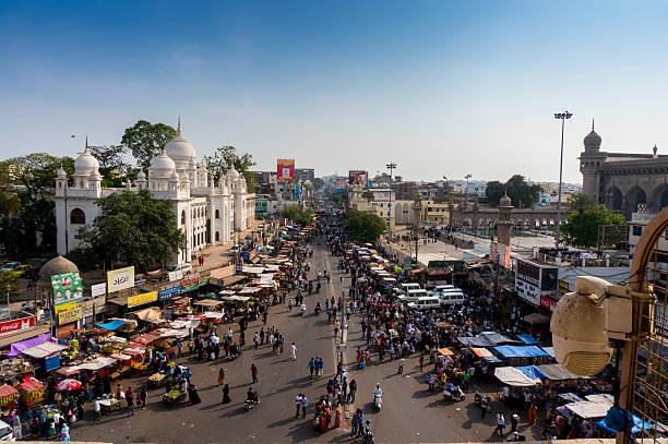 Markets surrounding the Charminar hyderabad Hyderabad, Telangana, India, 28th Feb 2016: Famous Laad market surrounding the Charminar in the old city area of Hyderabad. Streets packed with people and small shops char minar stock pictures, royalty-free photos & images