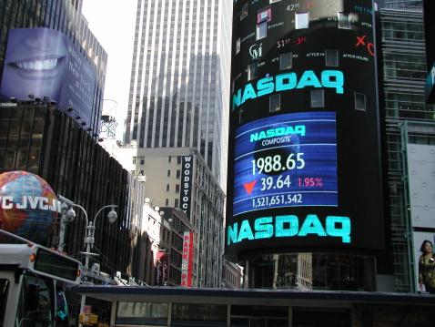 New York City, NY, USA - June 18, 2001: Times Square. NASDAQ Marketsite. Bus moves in left.  Brite smile and JVC ad, left.