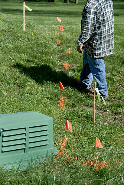 Marking Buried Cables in Back Yard stock photo