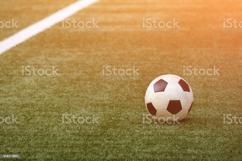 Marking of a football field on a beautiful juicy green grass and ball. stock photo