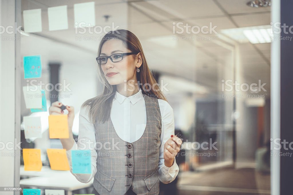 Marking progress of tasks stock photo