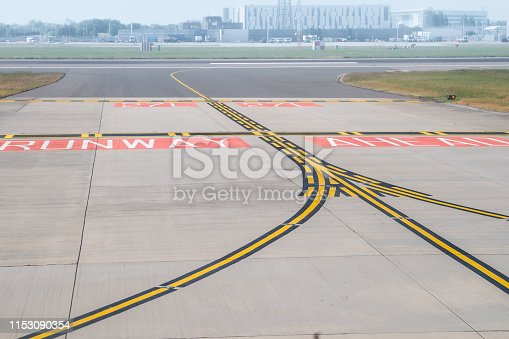 Markings to indicate that a runway is ahead at the end of a taxiway, Dulles International Airport, Dulles, Virginia, United States.