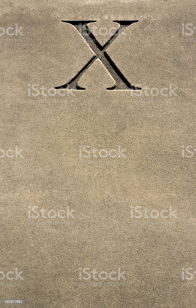 X marks the spot - stone carved numeral or letter royalty-free stock photo