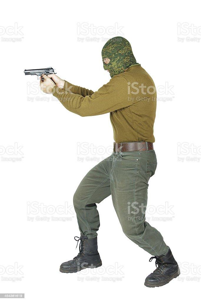 Marksman shooting with a gun royalty-free stock photo