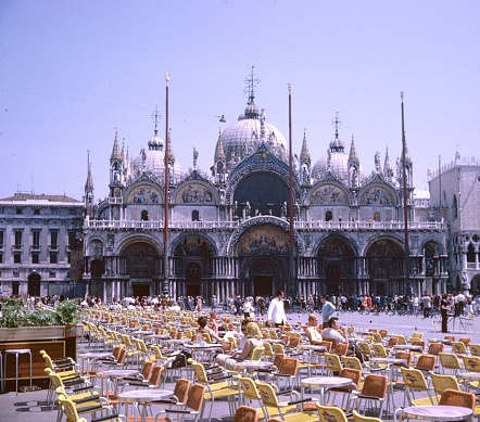 Venice, Venecia, Italy, 1969. The Marcus square in Venice. In the background the famous St. Mark's Basilica (Basilica di San Marco). The square is the center of Venice and the most popular place for tourists.