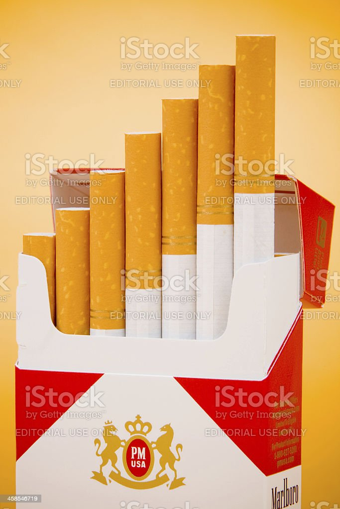 Marlboro Cigarettes In An Open Box With A Orange Background