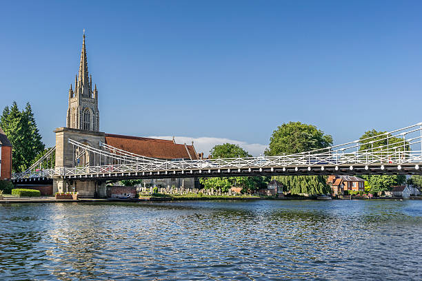 Marlow Bridge on the Thames Looking across the River Thames to Marlow in the county of Buckinghamshire buckinghamshire stock pictures, royalty-free photos & images