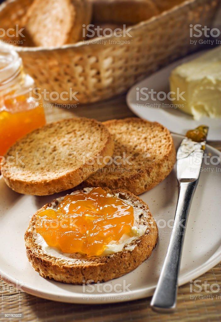 Marmalade on toast at breakfast table royalty-free stock photo