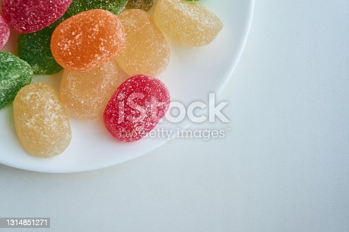 istock Marmalade sugar jelly colorful on white plate on white table 1314851271