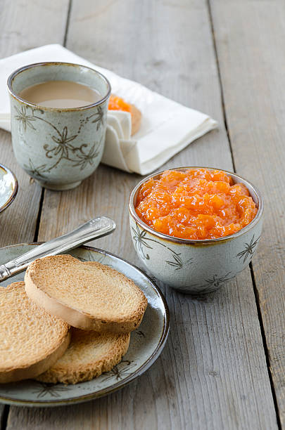 marmellata di zucca - fette biscottate foto e immagini stock