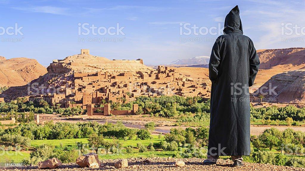 Maroccan man looking at Aït Benhaddou royalty-free stock photo