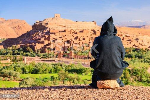 872393896 istock photo Maroccan man looking at Aït Benhaddou 474223427