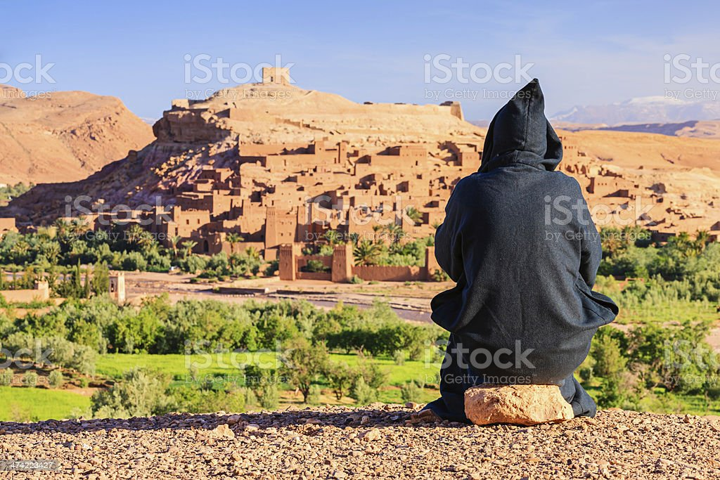 Maroccan man looking at Aït Benhaddou stock photo