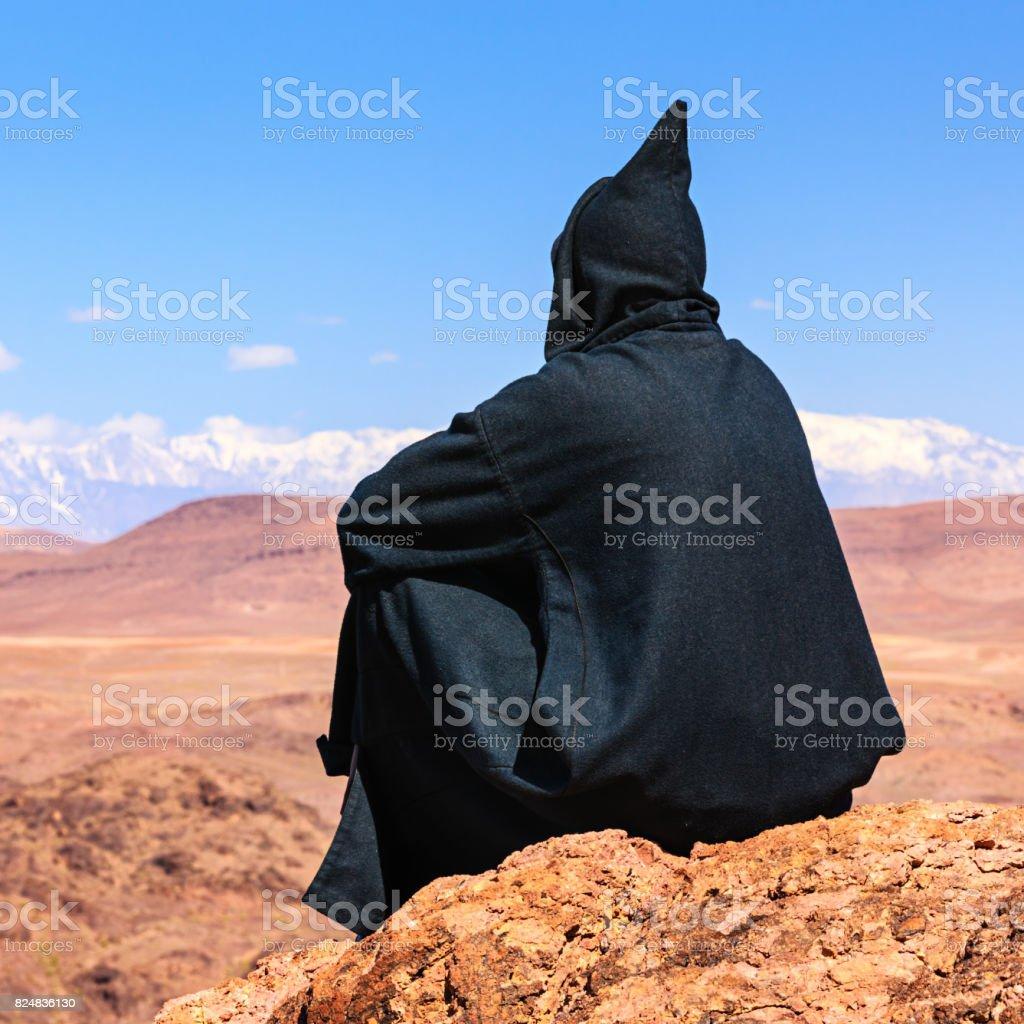Maroccan man looking at High Atlas mountain range stock photo
