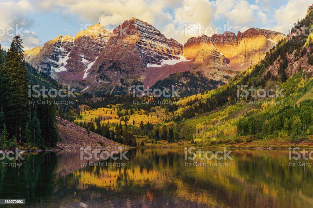 Maroon Bells and Lake at Sunrise, Colorado, USA stock photo