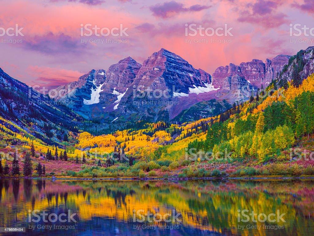 Maroon Bells autumn aspen trees,lake reflections,Aspen Colorado Dawn at Maroon Bells With Autumn Aspen Trees and Maroon Lake in the Rocky Mountains near Aspen Colorado 2015 Stock Photo