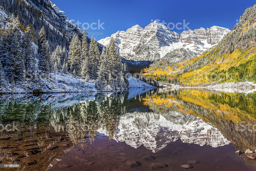 Maroon Bells, Colorado, snowy mountains reflect in the lake stock photo
