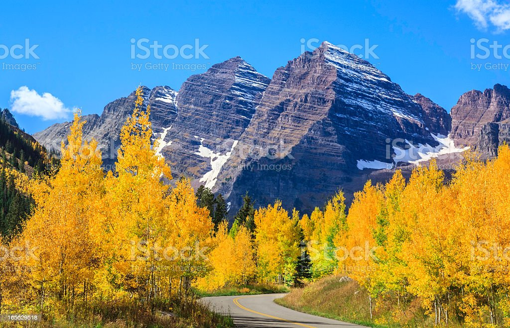 Maroon Bells mountain peaks & aspen trees in autumn color stock photo