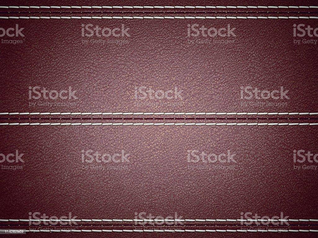 Maroon horizontal stitched leather background royalty-free stock photo