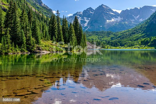 A Spring evening at colorful Maroon Lake, with Maroon Bells rising in the background, Aspen, Colorado, USA.