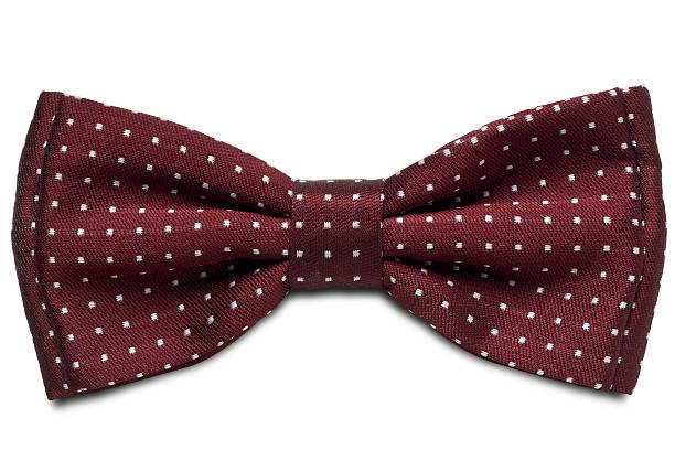 Maroon tie with white spots on a white background a red dotted bow-tie on white with clipping path bow tie stock pictures, royalty-free photos & images