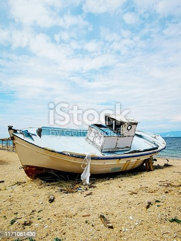 A lonely ship abandoned on the shore