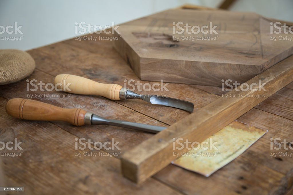 Marquetry Tools For Carver on Wooden Plank stock photo