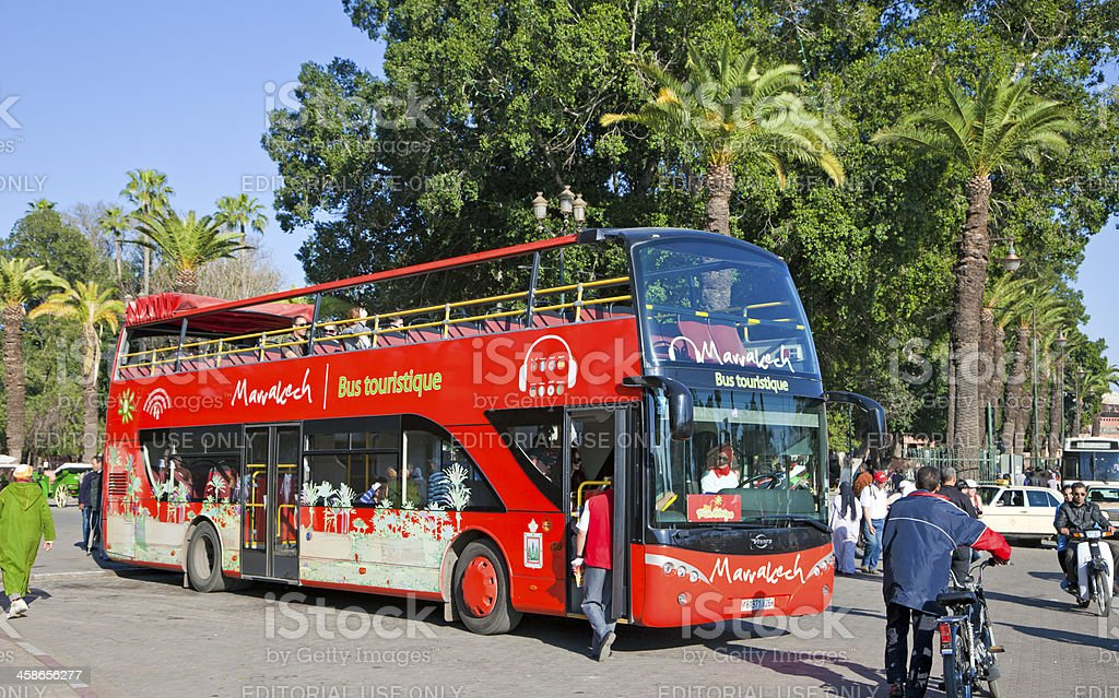Marrakech red sightseeing tourist bus stock photo