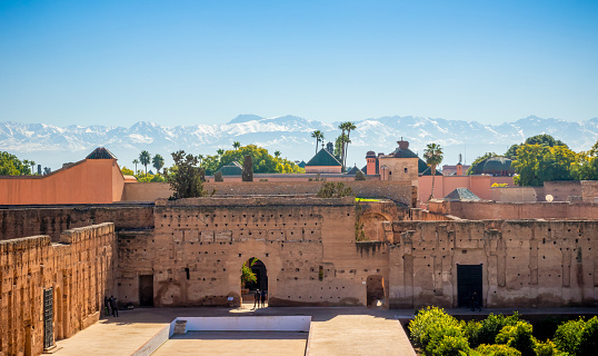 view of Marrakech city walls and Atlas mountains in the background