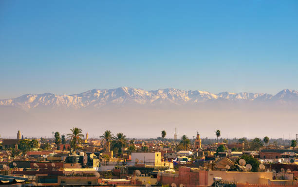 Marrakesh city skyline with Atlas mountains in the background stock photo