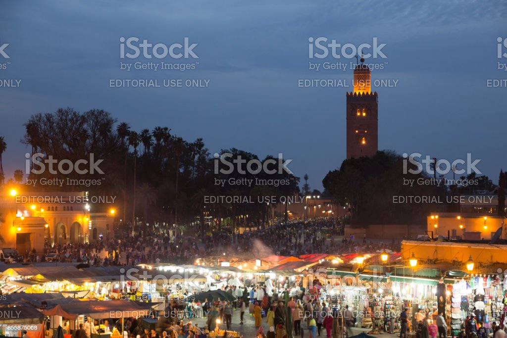 Marrakesh mosque and square food stalls stock photo